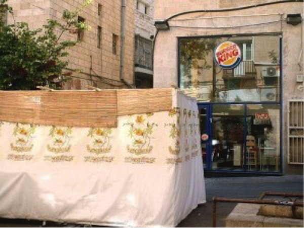 Sukka in front of kosher Burger King (photo credit: Judy Lash Balint)