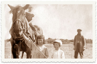 Children with a horse in Asher's field (Asher standing in the background)