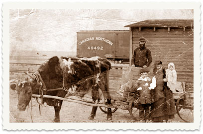 1911, mother Etil Cucuy (Bonov) with her 5-month-old son Noah on her arms, on her way to an operation in Saskatoon. Her son Aharon, 11, stands next to her. On the wagon is Shimon Bonov, Etil's father. Etil and her son Noah were the only ones to go on the trip on a wagon harnessed to a bull